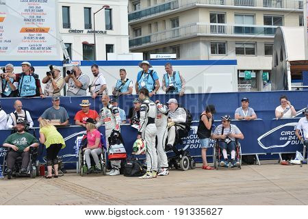 LE MANS FRANCE - JUNE 11 2017: Team of racers of Fabien Barthez - famous former french goalkeeper and racer. 11 june 2017- Weighing administrative and technical checks of the race cars