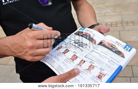 LE MANS FRANCE - JUNE 11 2017: Brochure with the team of racers of Fabien Barthez - famous former french goalkeeper and racer. 11 june 2017- Weighing administrative and technical checks of the race cars