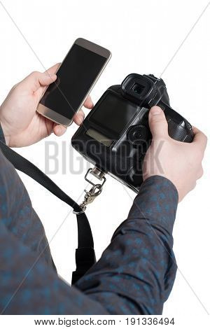 Male hands holding digital camera and mobile phone