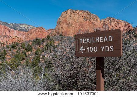 Trailhead 100 Yards Sign points toward beginning of hike