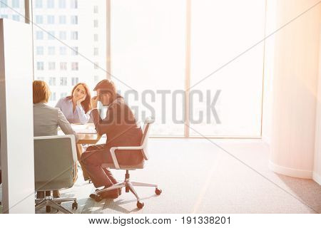 Exhausted businesspeople in meeting