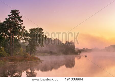 Misty Morning On The Lake. Fishing Boat At A Foggy River