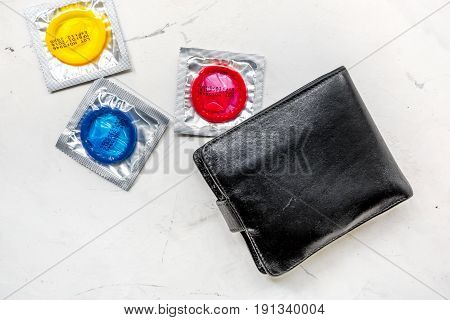 male contraception for safe sex with condoms on white desk background top view