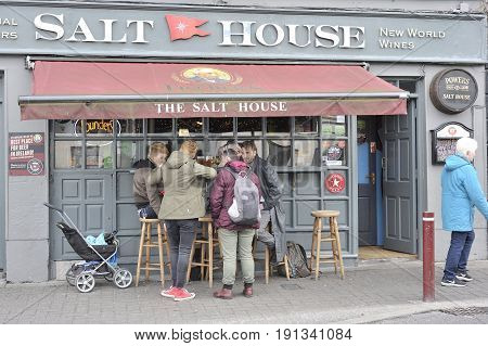 Salt House Bar, Galway, Ireland June 2017, Outside Of The Bar, A Gruop Of Fryends Is Having Fun.