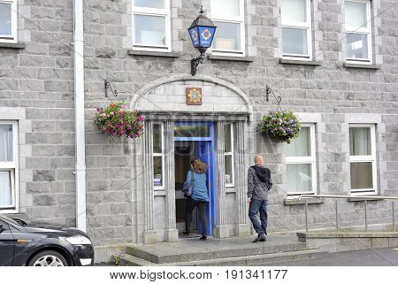 Galway, Ireland June 2017, Main Garda Station, Girl And Man Entering.