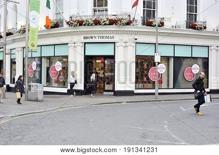 Shop Street Galway, Ireland June 2017, Brown Thomas Store , Girl Entering The Store , Some People Wa