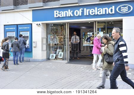 Mainguard Street, Galway, Ireland June 2017, Bank Of Ireland ,people Queuing At The Cashier, Banker