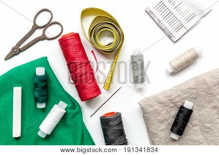tools for sewing for hobby set on white table background top view pattern