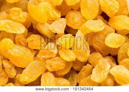 A Golden raisins close-up background . A photo