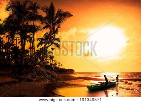 Silhouette of two Caribbean fisherman at early morning