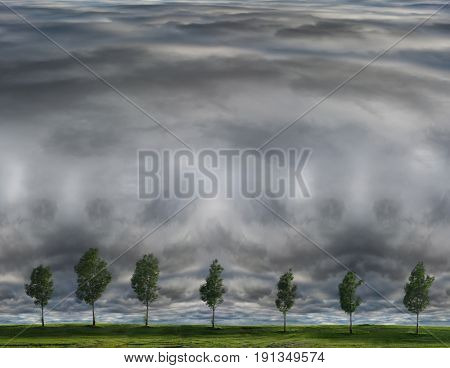 Storm clouds approaching area with trees at horizon