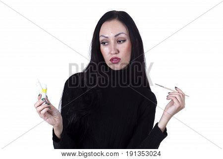 Young female artist at work on a white background