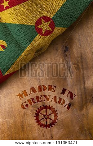 Stamp Made in Grenada a poster with the national flag of Grenada.