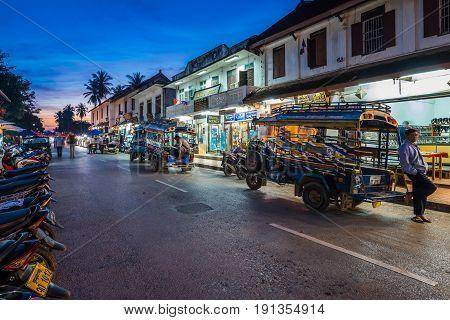Luang Prabang, Laos - December 21, 2015: A famous walking street in the world heritage site, Luang Prabang, Laos.