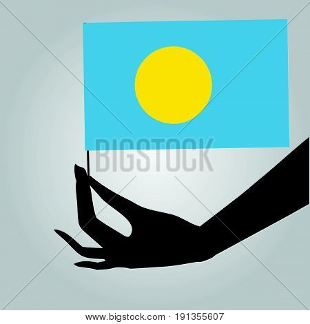 Flag of Palau in a female hand. Vector illustration.