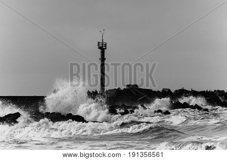 Impression of big waves from the North Sea breaking on the coast near Hoek van Holland, Netherlands