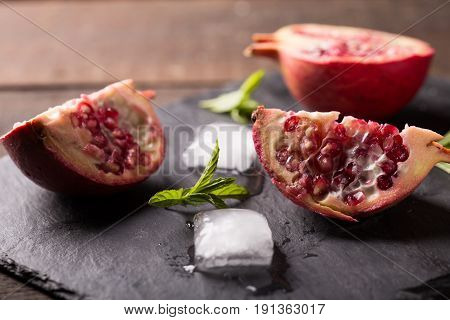 closeup of fresh juicy pomegranate on a table