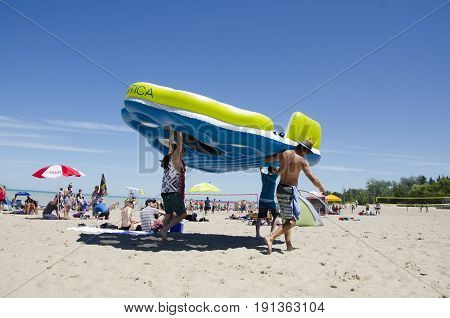 Grand Bend Ontario, Canada - July 02, 2016: Unidentified People In The Beach With Huge Floating Bed
