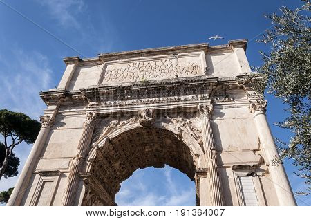 Detail of The Arch of Titus. It is a 1st-century honorific arch located on the Via Sacra Rome just to the south-east of the Roman Forum