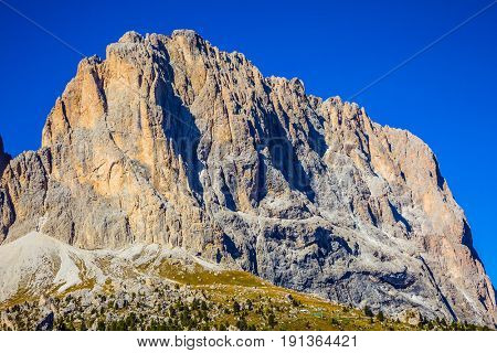 Indian summer in the Tyrol. Magnificent rock mountain on the picturesque Sella Pass in the Dolomites. The concept of extreme and ecological tourism
