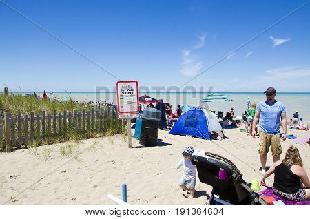 Grand Bend Ontario, Canada - July 02, 2016:  Unidentified People In The Beach Of Grand Bend  In Leis