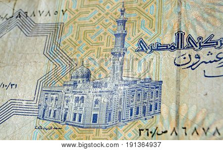 Reverse of the 25 piastres banknote from Egypt showing the historic Al-Sayida Aisha Mosque in Cairo. Used and slightly battered banknote photographed at an angle.