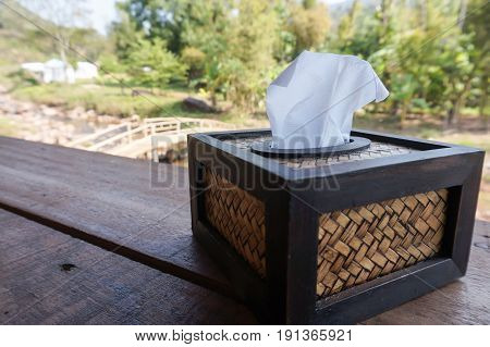 Tissue box on the table with nature background. Selective focus