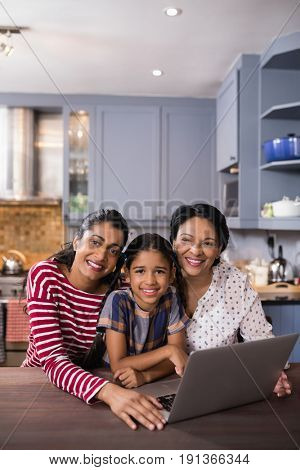 Portrait of happy multi-generation family in kitchen at home