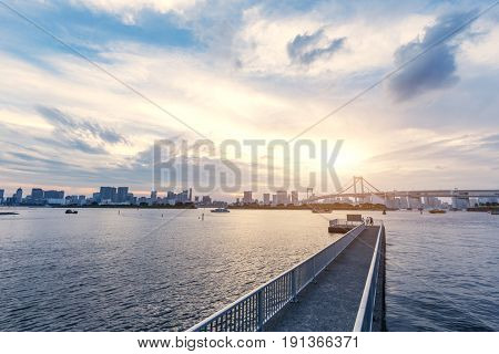 empty dock with cityscape of tokyo at sunset