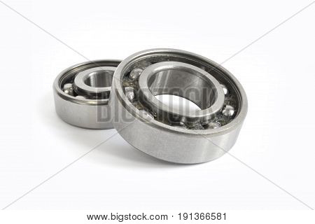 Two close-up bearings on the white background.