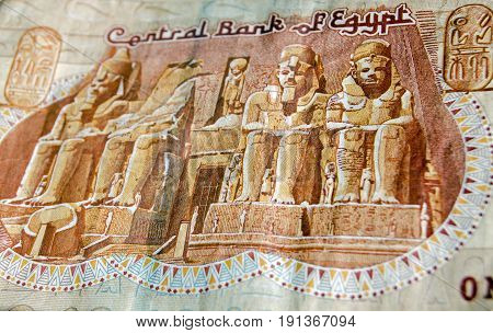 The famous Abu Simble Temple on the front of a one pound banknote from Egypt. Used banknote photographed at an angle.