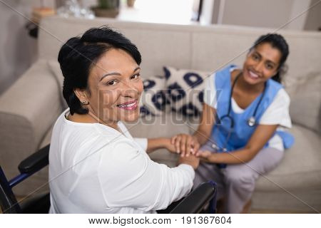 Portrait of patient with doctor sitting at home