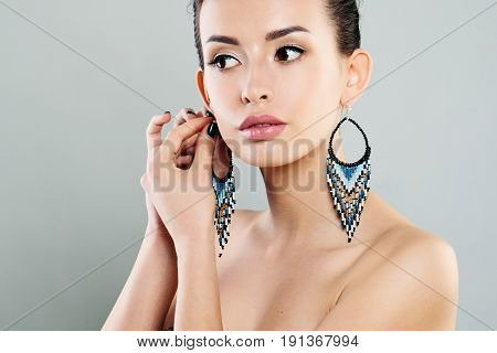 Fashion Girl with Makeup and Trendy Earrings. Cute Model Woman with Jewelry