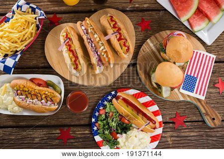Close-up of hot dogs on wooden table with 4th july theme