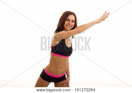 exciting energetic athlete in the top and shorts makes exercising isolated on white background