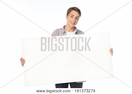 Smiling Teenage Boy Holding Blank Banner Isolated On White
