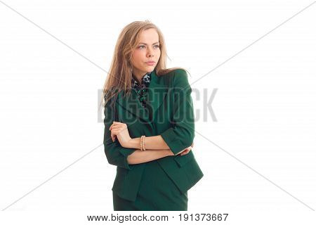 pretty amazing blonde stands hands clasped and looks up isolated on a white background close-up