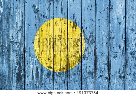 Flag of Palau painted on wooden frame
