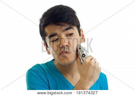 close-up portrait of a beautiful guy with razor isolated on white background