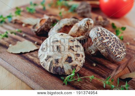 dried shiitake mushroom on a wooden board