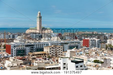Cityscape of Casablanca Morocco with the Hassan II mosque and the sea in the background. The Hassan II mosque is the largest mosque in Morocco.
