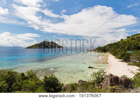travel, landscape and nature concept - island beach in indian ocean on seychelles