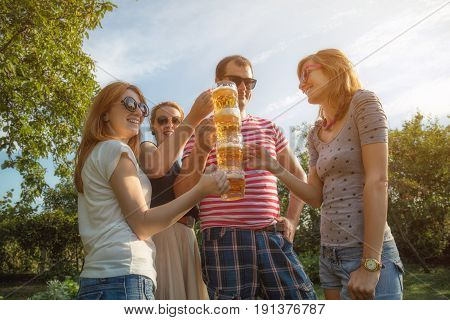 Several friends enjoying outdoors with the beer.