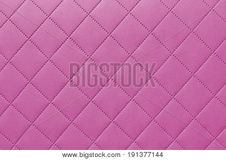 detail of sewn leather pink leather upholstery background pattern