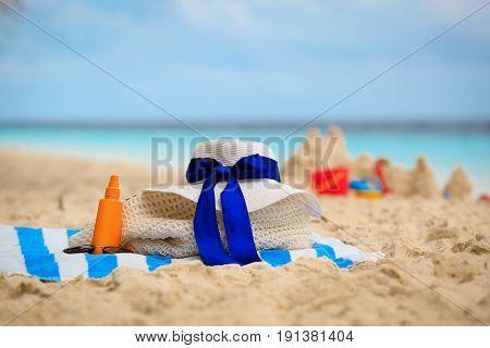 bag, suncream, glasses on tropical beach vacation