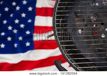 Close-up of barbeque against American flag