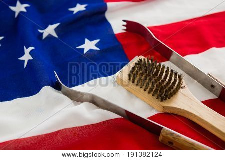 Tong and brush arranged on American flag
