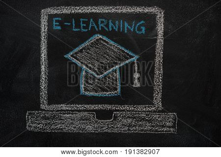 E-learning education icon drawn with chalk on blackboard