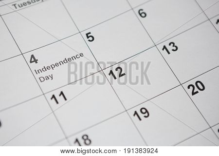 Close-up of perpetual calendar on American flag