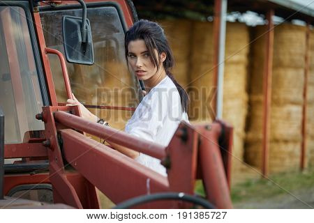 Female farmer and her tractor
